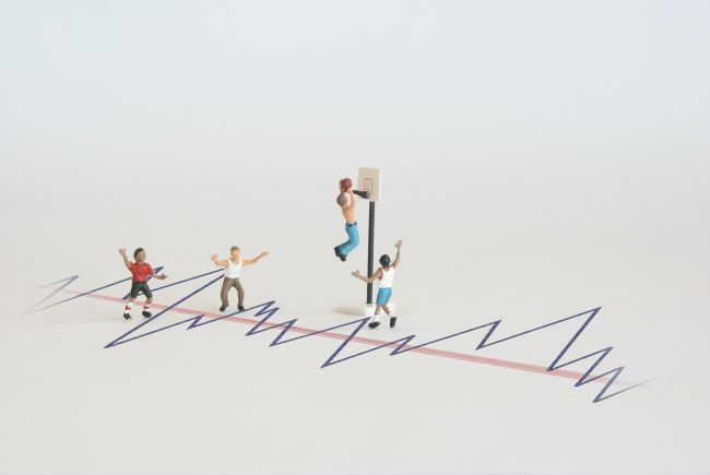 Small model figures climbing on a graph
