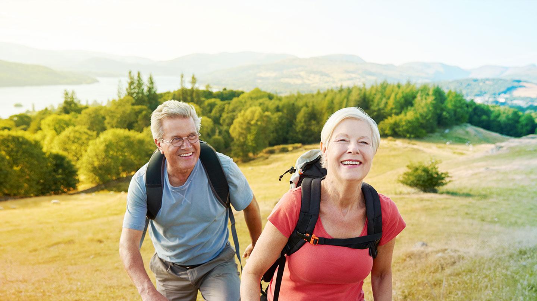 Couple hiking on hillside