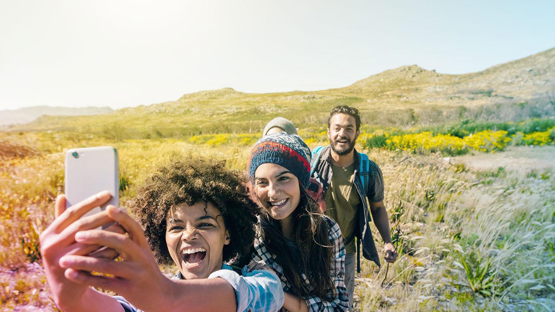 Group selfie on hillside