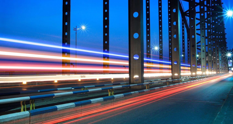 Light trails on a bridge at night